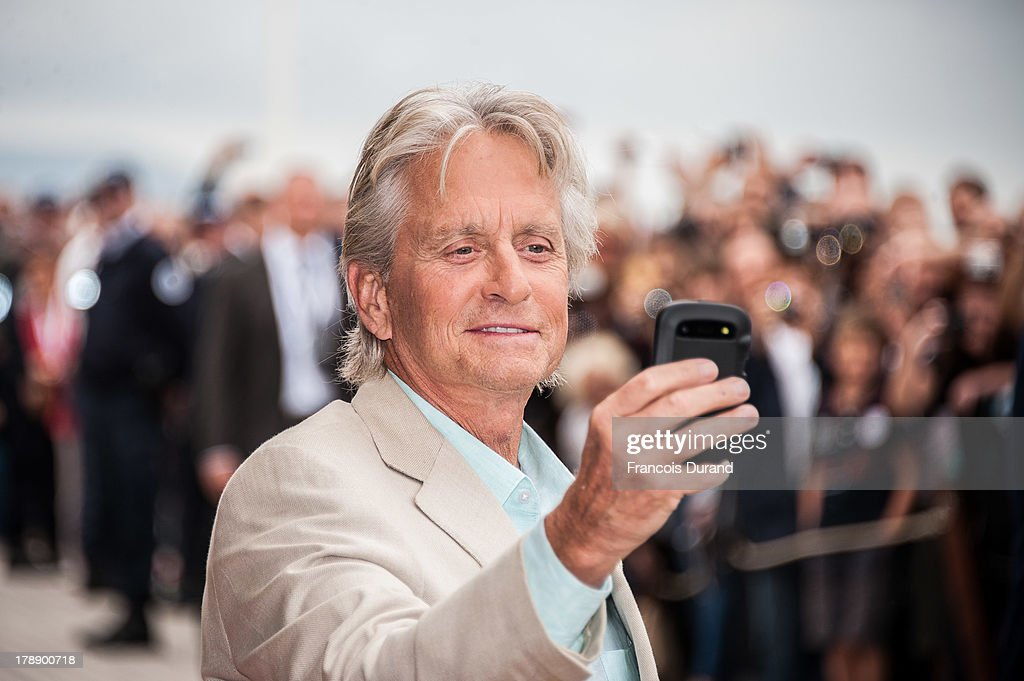 Michael Douglas attends a photocall next to the beach closet dedicated to him on the Promenade des Planches for the movie 'Behind the Candelabra'...