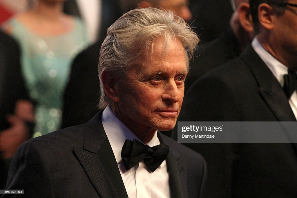 <a gi-track='captionPersonalityLinkClicked' href=/galleries/search?phrase=Michael+Douglas&family=editorial&specificpeople=171111 ng-click='$event.stopPropagation()'>Michael Douglas</a> departs the Premiere of 'Behind the Candelabra' during the 66th Annual Cannes Film Festival at Palais des Festivals on May 21, 2013 in Cannes, France.