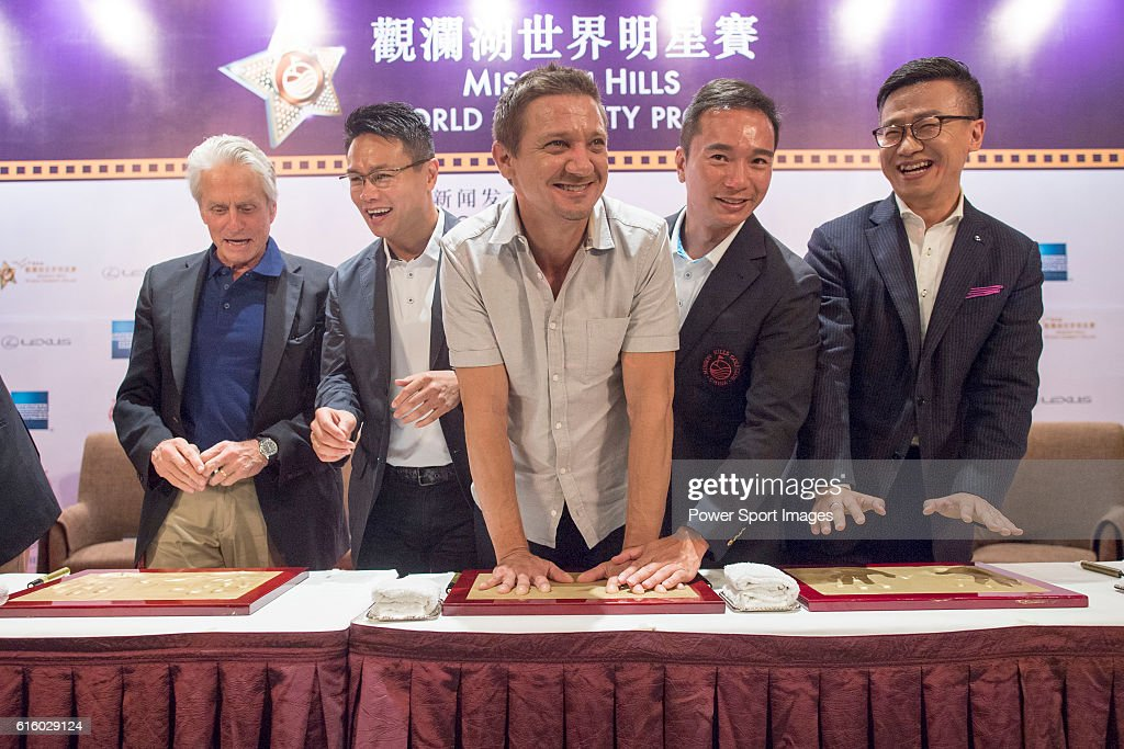 Michael Douglas, Dr. Ken Chu, Jeremy Renner, Tenniel Chu, Lizzy Zhu, Vice President of Lexus China during a hand print ceremony at the World Celebrity Pro-Am 2016 Mission Hills China Golf Tournament on October 21, 2016 in Haikou, China.