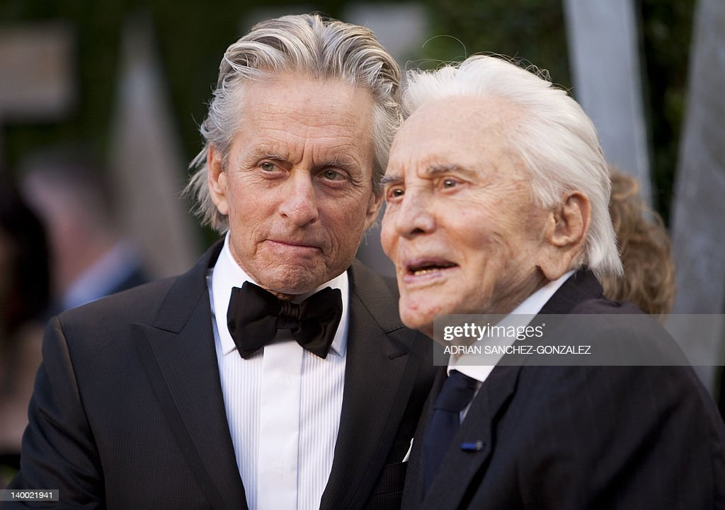 Michael Douglas (L) greets his father Kirk Douglas on the carpet as they arrive at the Vanity Fair Oscar Party, for the 84th Annual Academy Awards, at the Sunset Tower on February 26, 2012 in West Hollywood, California.