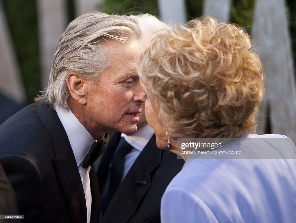 Michael Douglas (L) greets his parents Kirk (C) and Ann Douglas on the carpet as they arrive at the Vanity Fair Oscar Party, for the 84th Annual Academy Awards, at the Sunset Tower on February 26, 2012 in West Hollywood, California.
