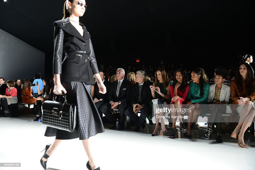 Michael Douglas, Hilary Swank, Zoe Saldana, Jada Pinkett Smith, Willow Smith and Paz Vega attend the Michael Kors Fall 2013 fashion show during Mercedes-Benz Fashion Week at The Theatre at Lincoln Center on February 13, 2013 in New York City.