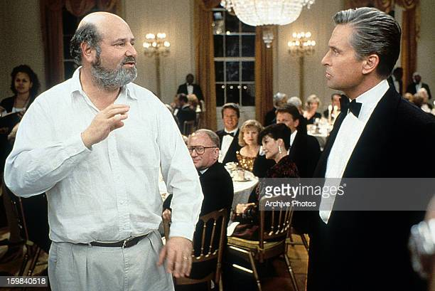 Michael Douglas listening to Director Rob Reiner in between scenes from the film 'The American President' 1995
