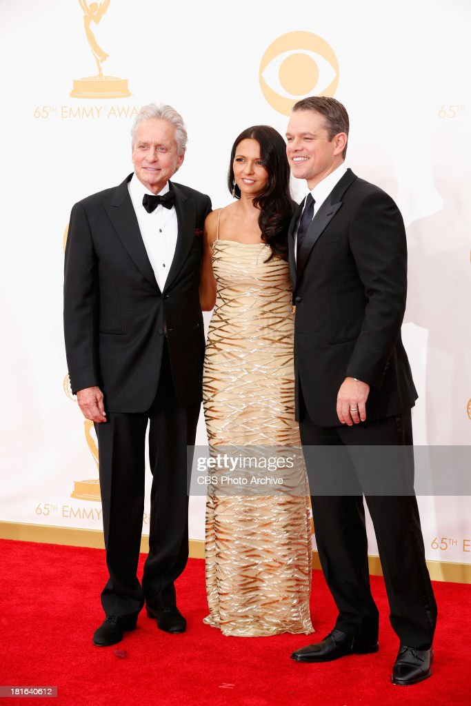 <a gi-track='captionPersonalityLinkClicked' href=/galleries/search?phrase=Michael+Douglas&family=editorial&specificpeople=171111 ng-click='$event.stopPropagation()'>Michael Douglas</a>, Luciana Barroso, and <a gi-track='captionPersonalityLinkClicked' href=/galleries/search?phrase=Matt+Damon&family=editorial&specificpeople=202093 ng-click='$event.stopPropagation()'>Matt Damon</a> on the Red Carpet for the 65th Primetime Emmy Awards,  which will be broadcast live across the country 8:00-11:00 PM ET/ 5:00-8:00 PM PT from NOKIA Theater L.A. LIVE in Los Angeles, Calif., on Sunday, Sept. 22 on the CBS Television Network.