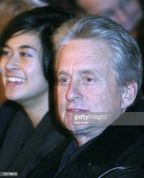 Michael Douglas sits in the audience watching his wife Catherine ZetaJones being roasted as Harvard University's Hasty Pudding Woman of the Year at...