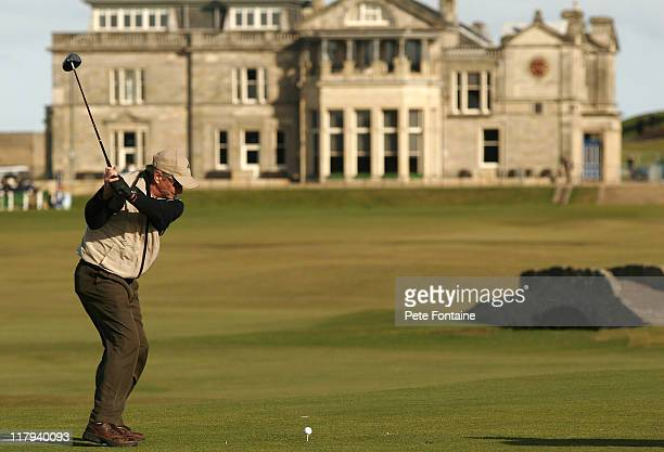 Michael Douglas tees off on the eighteenth hole of the St Andrews Old Course during practice day of the 2005 Dunhill Links Championship September 27...