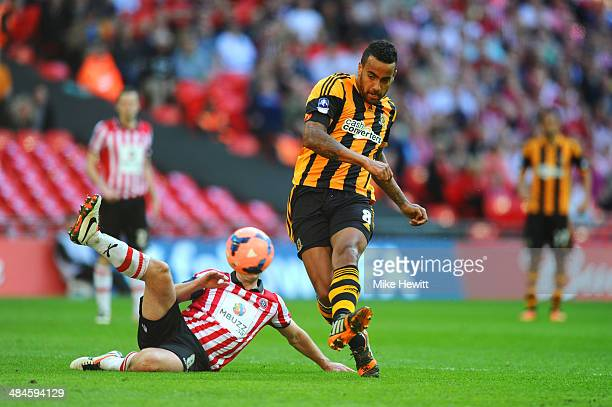 Michael Doyle of Sheffield United fails to stop Tom Huddlestone of Hull City scoring their third goal during the FA Cup with Budweiser semifinal...