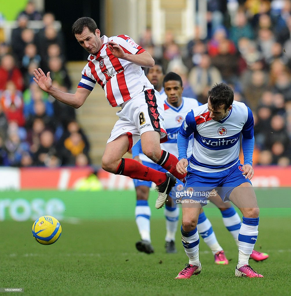 Michael Doyle of Sheffield United puts in a high tackle on Reading's Adam Le Fondre during the FA Cup Fourth Round match between Reading and Sheffield United at the Madejski Stadium on January 26, 2013 in London England.