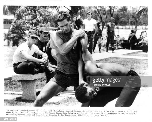 Michael Dudikoff effectively reckons with the irksome jeers off Steve James in a scene from the film 'American Ninja' 1985