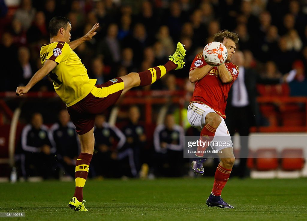 Michael Duff of Burnley clears the ball from Jamie Ward of Nottingham Forest during the Sky Bet Championship match between Nottingham Forest and Burnley at City Ground on October 20, 2015 in Nottingham, England.