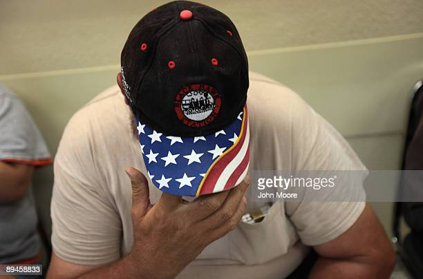Michael Dunn a day laborer with no health insurance awaits medical care in the Stout Street Clinic on July 29 2009 in Denver Colorado The clinic...
