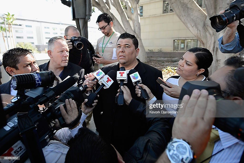 Michael Duran (C), who received nearly $1 million in a sex abuse settlement with the Roman Catholic Archdiocese of Los Angeles, speaks during a news conference with his wife Margarita Duran (R) on March 14, 2013 in Los Angeles, California. Duran wants Pope Francis to defrock Cardinal Roger Mahony over his role in the cover up. Duran is one of four men who reached a nearly $10 million settlement against the Los Angeles Archdiocese, Mahony, and ex-priest Michael Baker, who is in jail after pleading guilty pleaded to a dozen sex charges.