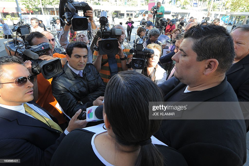 Michael Duran (R), who received nearly one million USD in a sex abuse settlement with the Roman Catholic Archdiocese of Los Angeles, speaks at a news conference on March 14, 2013 in Los Angeles, California. Duran wants Pope Francis to defrock Cardinal Roger Mahony over his role in the cover up. Duran is one of four men who reached a nearly $10 million settlement against the Los Angeles Archdiocese, Mahony, and ex-priest Michael Baker, who is in jail after pleading guilty pleaded to a dozen sex charges. AFP PHOTO/JOE KLAMAR