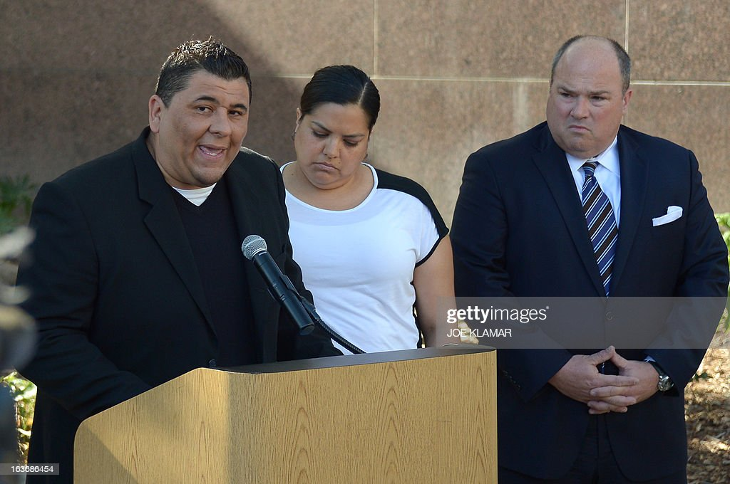 Michael Duran (L), who received nearly one million USD in a sex abuse settlement with the Roman Catholic Archdiocese of Los Angeles, speaks at a news conference along with his wife and attorney on March 14, 2013 in Los Angeles, California. Duran wants Pope Francis to defrock Cardinal Roger Mahony over his role in the cover up. Duran is one of four men who reached a nearly $10 million settlement against the Los Angeles Archdiocese, Mahony, and ex-priest Michael Baker, who is in jail after pleading guilty pleaded to a dozen sex charges. AFP PHOTO/JOE KLAMAR
