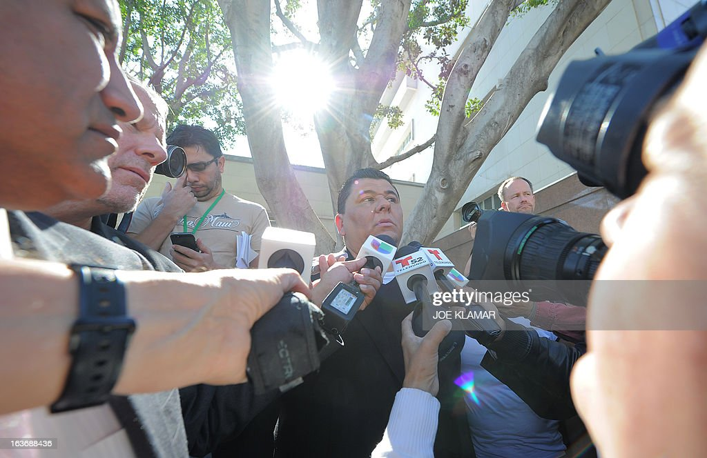 Michael Duran, who received nearly one million USD in a sex abuse settlement with the Roman Catholic Archdiocese of Los Angeles, speaks during a news conference on March 14, 2013 in Los Angeles, California. Duran wants Pope Francis to defrock Cardinal Roger Mahony over his role in the cover up. Duran is one of four men who reached a nearly $10 million settlement against the Los Angeles Archdiocese, Mahony, and ex-priest Michael Baker, who is in jail after pleading guilty pleaded to a dozen sex charges. AFP PHOTO/JOE KLAMAR