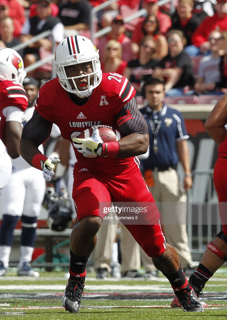 Michael Dyer #26 of the Louisville Cardinals runs against Florida International Panthers during their game at Papa John's Cardinal Stadium on September 21, 2013 in Louisville, Kentucky.