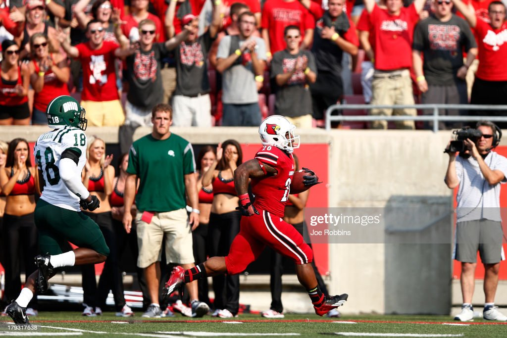 Michael Dyer #26 of the Louisville Cardinals rushes for a 46-yard touchdown in the third quarter of the game against the Ohio Bobcats at Papa John's Cardinal Stadium on September 1, 2013 in Louisville, Kentucky. Louisville won 49-7.