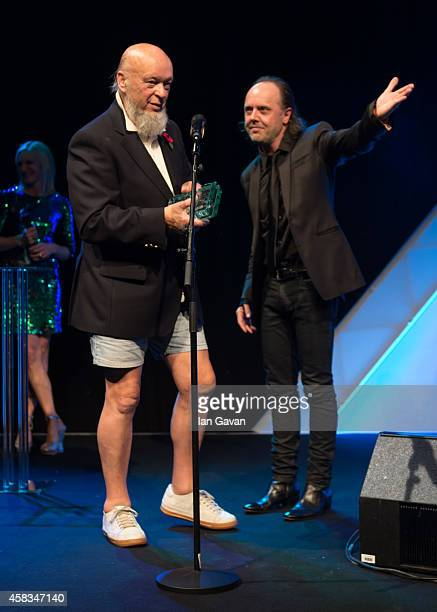 Michael Eavis accepts the Music Industry Trust Award 2014 from Lars Ulrich the Music Industry Trust Awards at Grosvenor House Hotel on November 3...