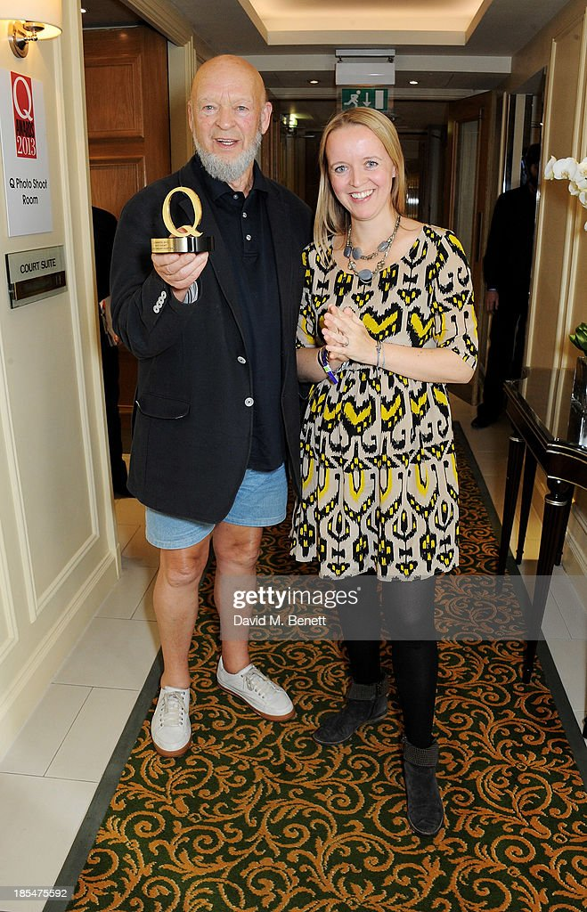Michael Eavis (L) and daughter Emily Eavis pose with the award for Best Event for the Glastonbury Festival in the press room at The Q Awards at The Grosvenor House Hotel on October 21, 2013 in London, England.