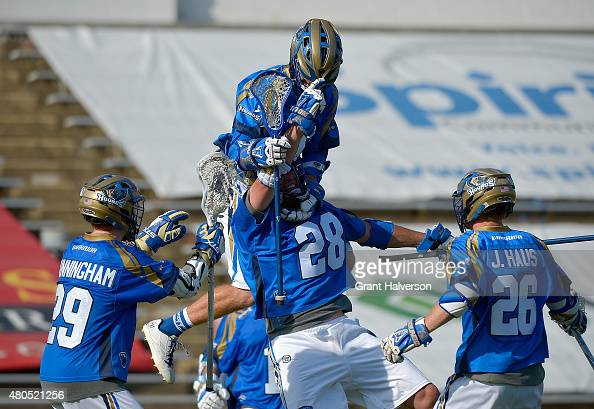 Michael Ehrhardt of the Charlotte Hounds celebrates with teammates after scoring the gametying goal against the Florida Launch with seconds left in...