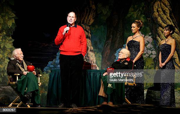 Michael Eisner with Joe Grant and Frank Thomas Disney Animators attend the opening of 'Snow White An Enchanting New Musical' at Fantasyland Theatre...
