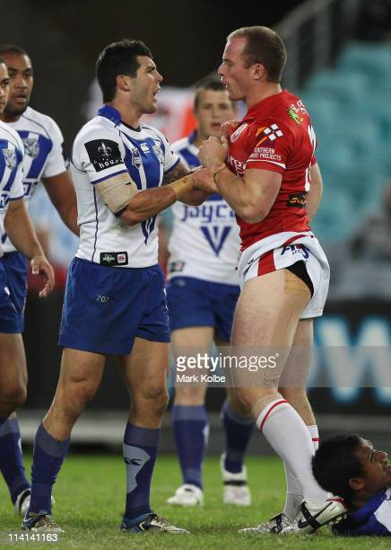 Michael Ennis of the Bulldogs and Beau Scott of the Dragons exchange words during the round 10 NRL match between the Canterbury Bulldogs and the St...