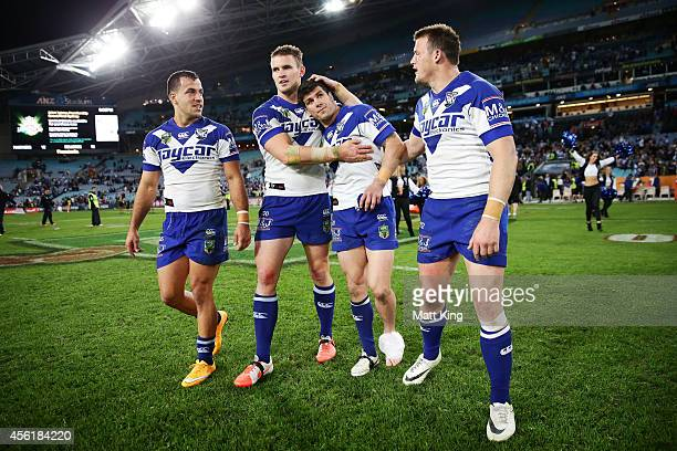 Michael Ennis of the Bulldogs celebrates victory with team mates at the end of the NRL Second Preliminary Final match between the Penrith Panthers...