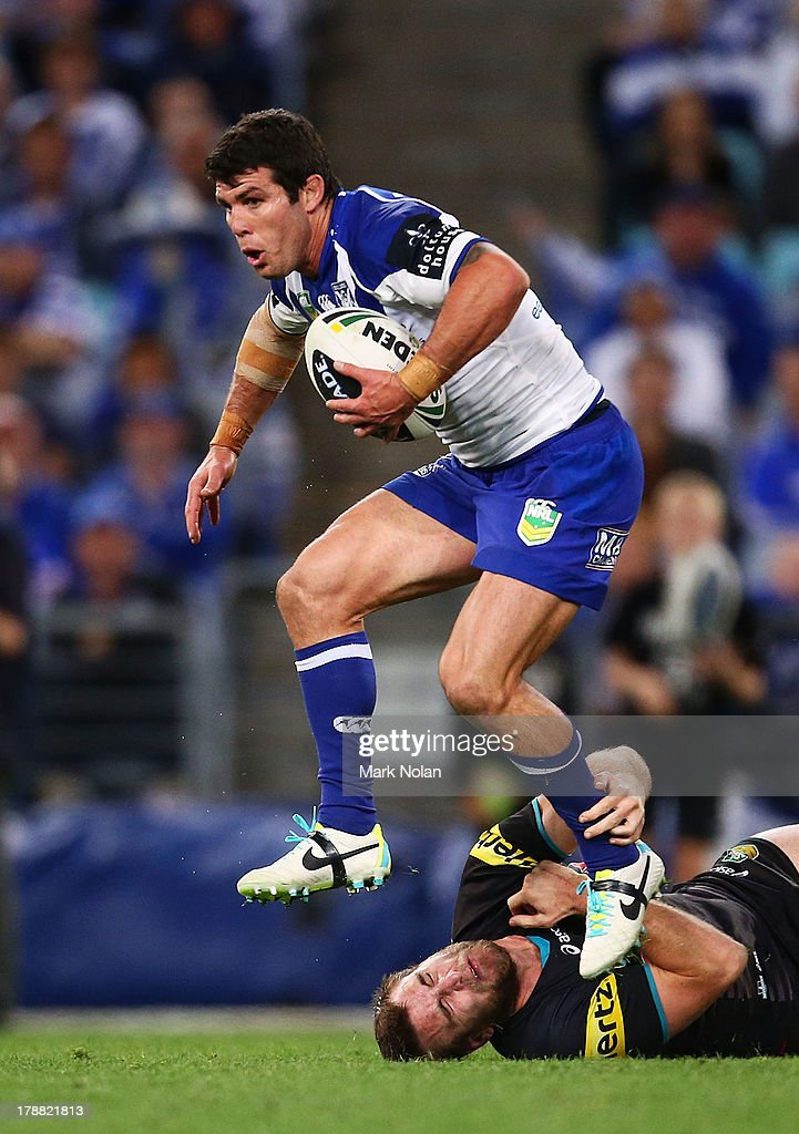 <a gi-track='captionPersonalityLinkClicked' href=/galleries/search?phrase=Michael+Ennis&family=editorial&specificpeople=224839 ng-click='$event.stopPropagation()'>Michael Ennis</a> of the Bulldogs jumps out of a tackle during the round 25 NRL match between the Canterbury Bulldogs and the Penrith Panthers at ANZ Stadium on August 31, 2013 in Sydney, Australia.