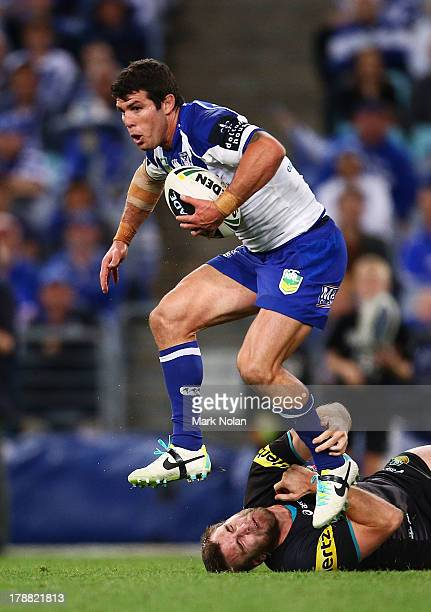 Michael Ennis of the Bulldogs jumps out of a tackle during the round 25 NRL match between the Canterbury Bulldogs and the Penrith Panthers at ANZ...