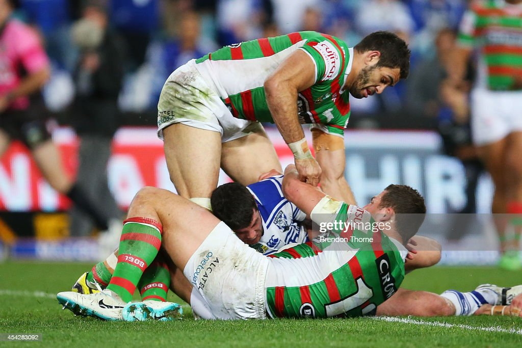 Michael Ennis of the Bulldogs scores a try during the round 25 NRL match between the Canterbury Bulldogs and the South Sydney Rabbitohs at ANZ Stadium on August 28, 2014 in Sydney, Australia.