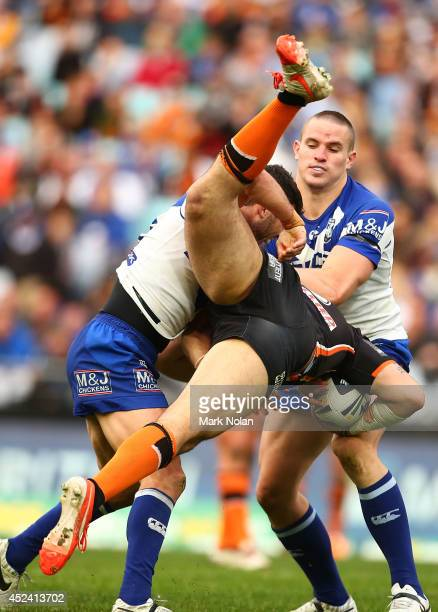 Michael Ennis of the Bulldogs up ends Aaron Woods of the Tigers during the round 19 NRL match between the Wests Tigers and the Canterbury Bulldogs at...