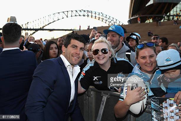 Michael Ennis of the CronullaSutherland Sharks poses with fans during the NRL Grand Final Fan Day at Sydney Opera House on September 29 2016 in...