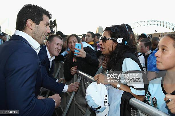 Michael Ennis of the CronullaSutherland Sharks signs autographs during the NRL Grand Final Fan Day at Sydney Opera House on September 29 2016 in...