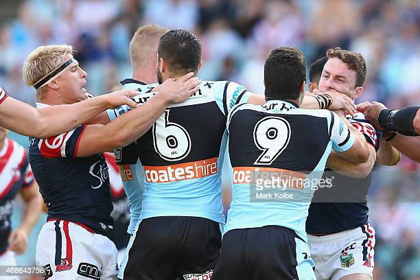 Michael Ennis of the Sharks and James Maloney of the Roosters scuffle during the round five NRL match between the Sydney Roosters and the Cronulla...