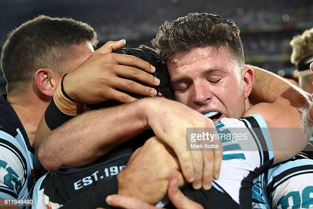 Michael Ennis of the Sharks celebrates with Chad Townsend of the Sharks after winning the 2016 NRL Grand Final match between the Cronulla Sharks and...