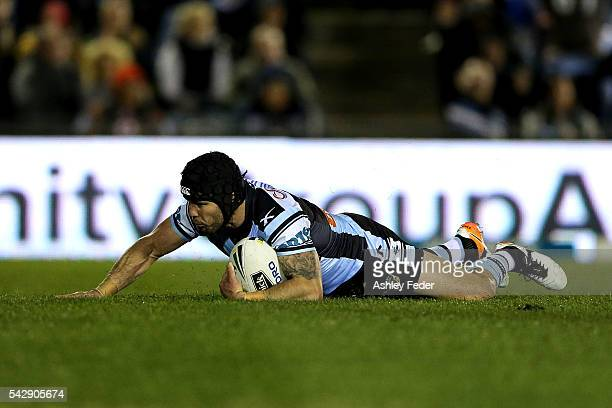 Michael Ennis of the Sharks scores a try with team mates during the round 16 NRL match between the Cronulla Sharks and the New Zealand Warriors at...