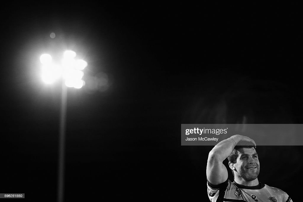 Michael Ennis of the Sharks watches on after the round 25 NRL match between the Cronulla Sharks and the Sydney Roosters at Shark Park on August 27, 2016 in Sydney, Australia.