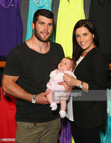 Michael Ennis poses with his wife Simone Ennis and daughter Evelyn during the launch of Australia's Nike flagship store on October 29 2014 in Sydney...