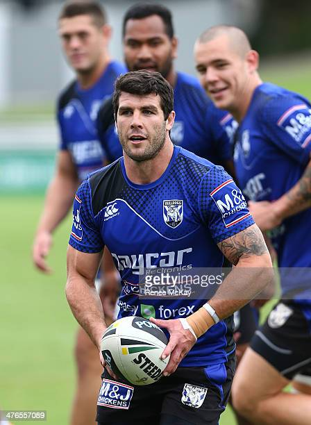 Michael Ennis runs the ball during a Canterbury Bulldogs NRL training session at Belmore Sports Ground on March 4 2014 in Sydney Australia