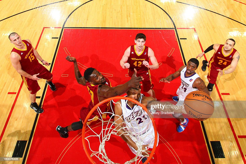 Michael Eric #50 of the Canton Charge attempts to defend a layup by <a gi-track='captionPersonalityLinkClicked' href=/galleries/search?phrase=Morris+Almond&family=editorial&specificpeople=4378315 ng-click='$event.stopPropagation()'>Morris Almond</a> #21 of the Iowa Energy in an NBA D-League game on January 25, 2013 at the Wells Fargo Arena in Des Moines, Iowa.