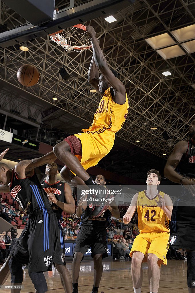Michael Eric #50 of the Canton Charge dunks the ball against Christian Polk #7 of the Springfield Armor at the Canton Memorial Civic Center on November 24, 2012 in Canton, Ohio.