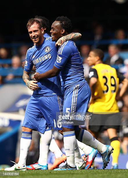 Michael Essien celebrates with goal scorer Raul Meireles of Chelsea during the Barclays Premier League match between Chelsea and Blackburn Rovers at...