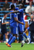 Michael Essien of Chelsea celebrates scoring his goal with team mate John Obi Mikel during the Pre Season Friendly match between Crystal Palace and...