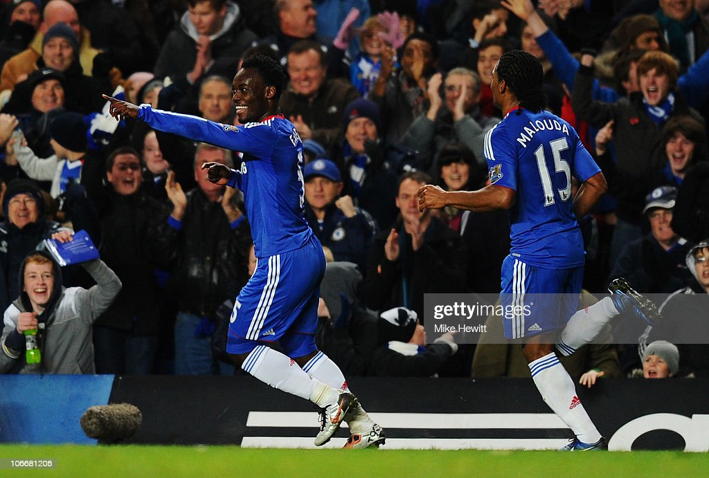 <a gi-track='captionPersonalityLinkClicked' href=/galleries/search?phrase=Michael+Essien&family=editorial&specificpeople=523500 ng-click='$event.stopPropagation()'>Michael Essien</a> of Chelsea celebrates with <a gi-track='captionPersonalityLinkClicked' href=/galleries/search?phrase=Florent+Malouda&family=editorial&specificpeople=228109 ng-click='$event.stopPropagation()'>Florent Malouda</a> (R) as he scores their first goal during the Barclays Premier League match between Chelsea and Fulham at Stamford Bridge on November 10, 2010 in London, England.