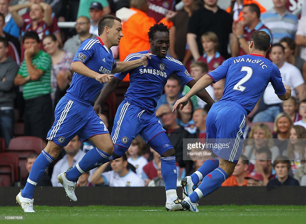 <a gi-track='captionPersonalityLinkClicked' href=/galleries/search?phrase=Michael+Essien&family=editorial&specificpeople=523500 ng-click='$event.stopPropagation()'>Michael Essien</a> of Chelsea (C) celebrates with <a gi-track='captionPersonalityLinkClicked' href=/galleries/search?phrase=John+Terry&family=editorial&specificpeople=171535 ng-click='$event.stopPropagation()'>John Terry</a> (L) and <a gi-track='captionPersonalityLinkClicked' href=/galleries/search?phrase=Branislav+Ivanovic&family=editorial&specificpeople=607152 ng-click='$event.stopPropagation()'>Branislav Ivanovic</a> as he scores their first goal during the Barclays Premier League match between West Ham United and Chelsea at the Boleyn Ground on September 11, 2010 in London, England.