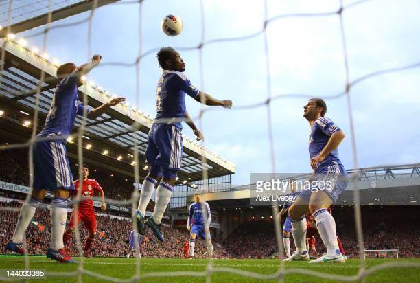 Michael Essien of Chelsea fails to clear the ball as Daniel Agger of Liverpool scores their third goal during the Barclays Premier League match...