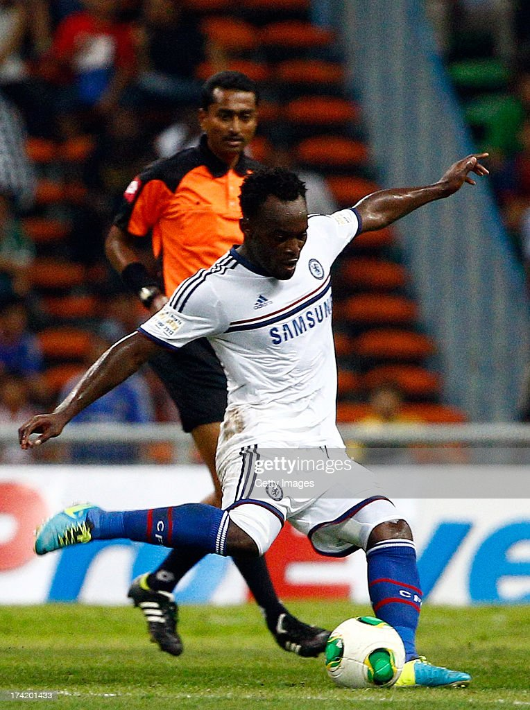Michael Essien of Chelsea FC kicks the ball durng the match between Chelsea and Malaysia XI on July 21, 2013 at the Shah Alam Stadium, Kuala Lumpur, Malaysia.