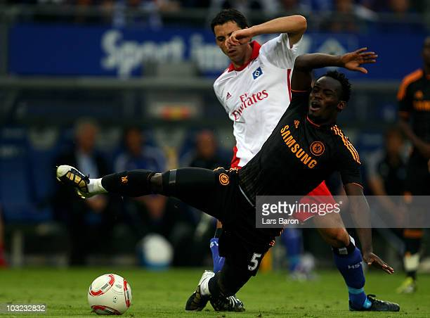 Michael Essien of Chelsea is challenged by Gojko Kacar of Hamburg during a pre season friendly match between Hamburger SV and Chelsea FC at Imtech...