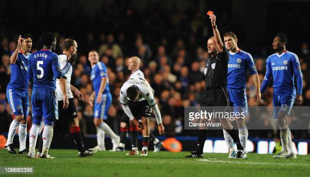 Michael Essien of Chelsea is sent off by referee Martin Atkinson during the Barclays Premier League match between Chelsea and Fulham at Stamford...