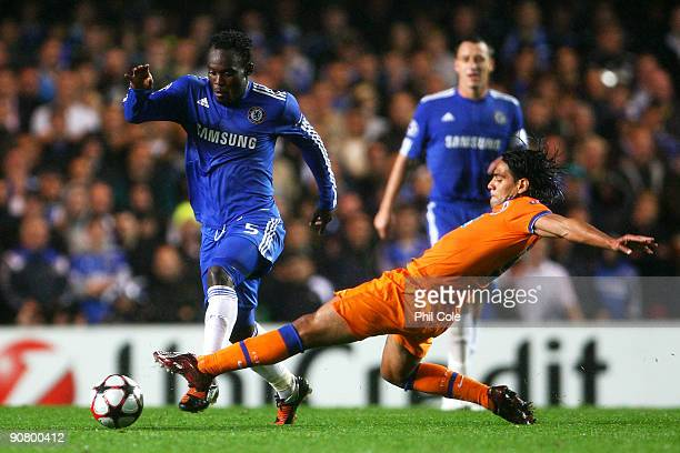 Michael Essien of Chelsea is tackled by Falcao of Porto during the UEFA Champions League Group D match between Chelsea and FC Porto at Stamford...